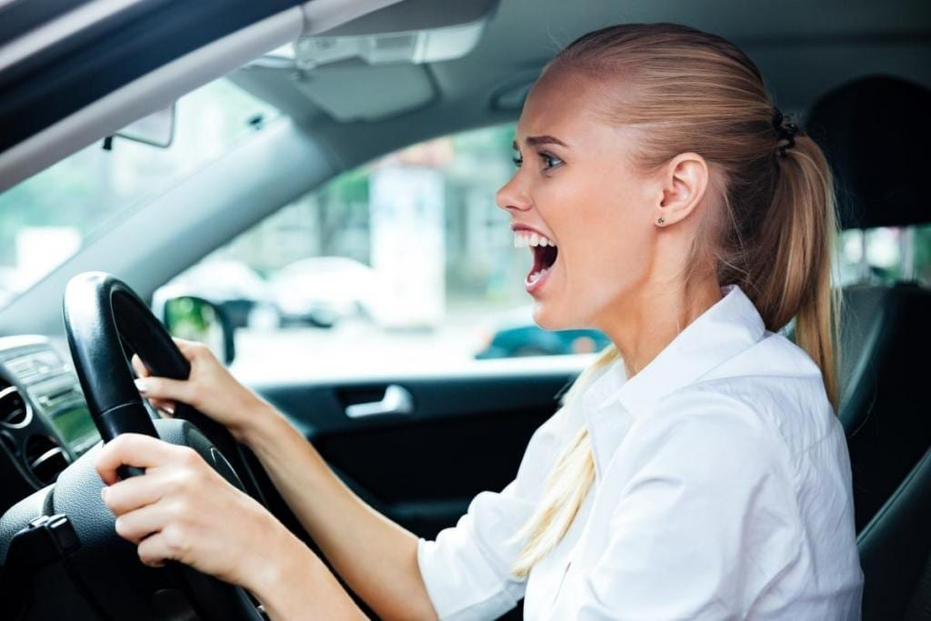 Business Woman Driving a Car on the Road
